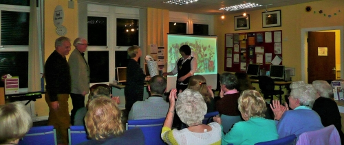 Berni Williams, Silverdale Library's amazing supevisor, receiving a medal for being the fastest tickt-seller on the tour when the verse-drama TOWN came to Silverdale!